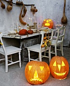 Halloween pumpkins and rustic table (laid)