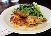 Half a roast chicken with salad