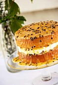Sponge cake with cream and passion fruit sauce