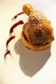 Roast duck leg on puff pastry case
