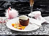 Chocolate pudding with vanilla ice cream and fruit