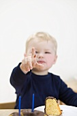 Small boy holding up fingers to show he is 2 years old