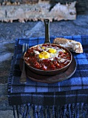 Paprika sausage with eggs in a frying pan