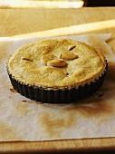 Peach pie in baking tin