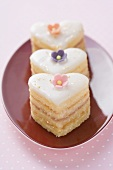 Three small heart-shaped cakes
