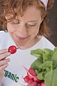 Woman with fresh organic radishes