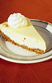 A piece of Key lime pie with whipped cream (USA)