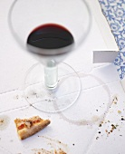 Remains of pizza and red wine on pizza box