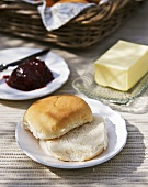 Bread roll with butter and jam