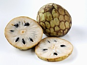 Cherimoya, whole and sliced