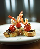 Cocktail tomatoes and prawns on toast