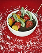 Fruit skewers with chocolate sauce