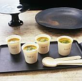 Pumpkin soup in beakers