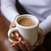 Hands holding a mug of hot chocolate