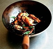 Fried crab claws with chilli and sweet basil