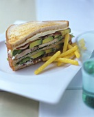 Double-decker sandwich, chips beside it
