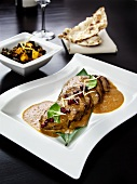 Lamb with Indian sauce and pomegranate seeds