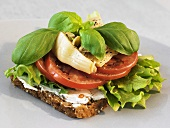 Whole-grain bread topped with soft cheese, tomatoes & artichokes