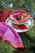 Decorative picnicware on conifer branches