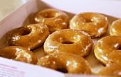 Iced doughnuts in a cardboard box