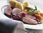 Roast duck breast (medium rare) with raspberries & vegetables
