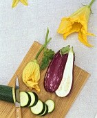 Courgette, courgette flowers and an aubergine