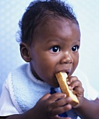Baby chewing on a rusk