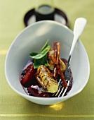 Ricotta dumplings with peppered plums and basil
