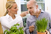 A couple examining fresh herbs