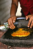 Indian woman preparing a curry