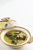 Beef fillet with green curry and winter bamboo tips