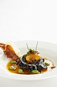 Squid ink pasta with egg and Pata Negra ham