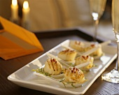 Grilled scallops served on porcelain spoons