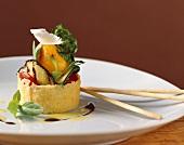 Grilled vegetables in Parmesan basket with grissini