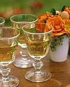 White wine in glasses, posy of autumnal flowers