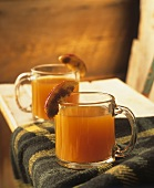 Hot cider in two glass cups
