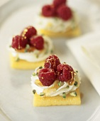 Sweet polenta slices topped with raspberries & pistachios