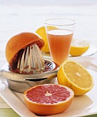 Grapefruits, citrus press and grapefruit juice
