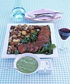 Beef fillet on chard with vegetables and herb sauce
