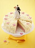 A wedding cake with a piece cut