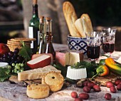 Still life with empanadas, cheeses, bread and wine