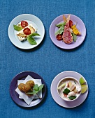 International snacks: sheep's cheese, red mullet, falafel, coconut soup