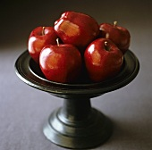 Red apples (Red Delicious) in a pedestal bowl