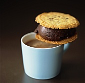 Chocolate sandwich (made with biscuits) & cup of hot chocolate