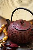 Asian red cast-iron teapot