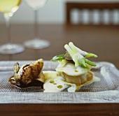 Chicken wing with potato ravioli, truffle and foam sauce