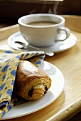 A pain au chocolat with coffee