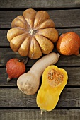 An assortment of pumpkins & squashes on wooden background