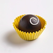 A chocolate in a yellow paper case