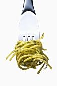 Spaghetti with rocket pesto on a fork